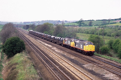 37520+37506 pass Tupton whilst working 6M47 1050 Lackenby BSC-Corby BSC steel coils on 10/05/1988.