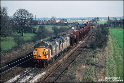 37351+37250 pass Knabbs Bridge, Melton Ross whilst working 6T26 1233 Immingham Ore Terminal-Santon on 06/03/1992.