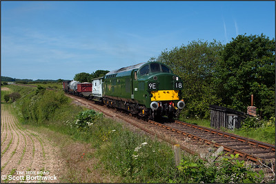 D6732 (37032) passes Dead Man's Hill with a mixed freight for Sheringham on 12/06/2014.