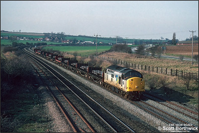 37514 passes Melton Ross with a trainload of steel slab for Grimsby Docks on 06/03/1992.