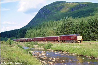 37401 'The Royal Scotsman' hauls 1H90 1407 Edinburgh Waverley-Taynuilt 'Royal Scotsman' through Glen Lochy on 04/08/2002.