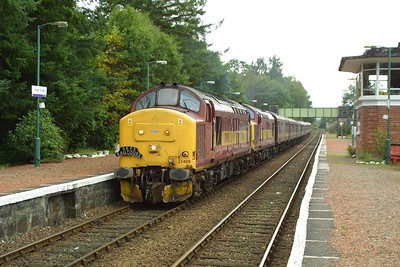 37408+37427 arrive at Spean Bridge with 1Z38 1450 Mallaig-Edinburgh Waverley on 22/09/2001. The RETB would be exchanged here prior to the train continuing on its journey south.