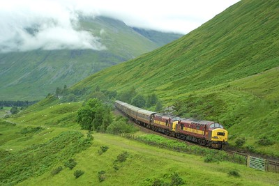 The 'classic' shot at County March Summit. 37411+37427 are pictured in typical West Highland weather about to crest the summit whilst working SRPS's charter 1Z19 1440 Mallaig-Edinburgh Waverley on 03/08/2002.