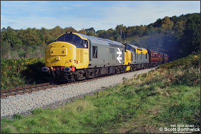 37906+37175 emerge from Foley Park Tunnel at the head of the 1330 Kidderminster-Bridgnorth service on the 04/10/2002 during the 2002 SVR Autumn Diesel Gala.
