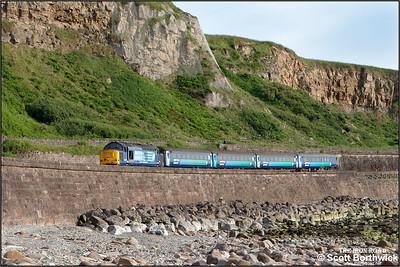 37425 'Sir Robert McAlpine/Concrete Bob' skirts Tanyard Bay, Parton with 2C47 1732 Barrow in Furness-Carlisle on 24/06/2016.