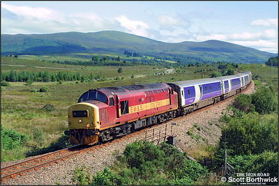 37415 is pictured shortly after departing from Spean Bridge whilst in charge of 1Y11 0450 Edinburgh Waverley-Fort William (including sleeping cars from London Euston) on 02/08/2002. The train was a mere 2 hours late at this point.