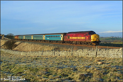 With snow on the distant mountain tops, 37408 'Loch Rannoch' top & tails 37411 at Waitby whilst working 1E23 1333 Carlisle-Leeds on 29/12/2003.