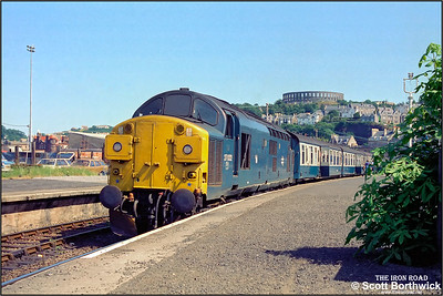 37022 stands in the sunshine at Oban on 22/07/1983 with 1T32 1225 Oban-Glasgow Queen Street.