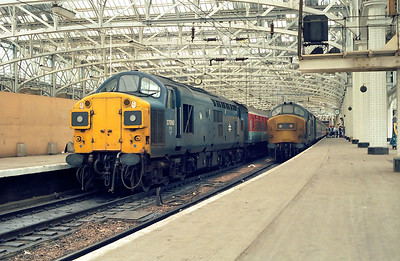 37090 awaits departure from Glasgow Central on 16/07/1985 with 1A03 1130 Glasgow Central-Stranraer Harbour. 37300 stands on 1Z31 1110 Glasgow Central-Ayr relief service which was eventually CAPED and ran ECS to Polmadie instead.