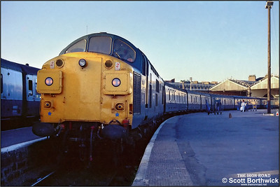 At 0620, there are still 20 minutes to go until departure as 37035 awaits time at Inverness with 2K03 0640 Inverness-Wick on 21/07/1983.