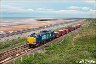 37612 passes Seascale golf course whilst in charge of the low level waste trip, 7C20 0756 Sellafield BNF-Drigg, on 27/06/2013.
