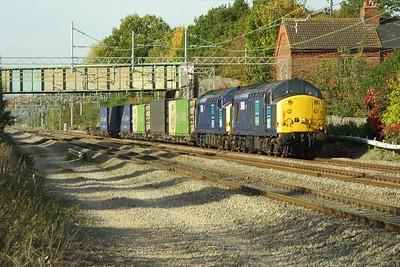 37605+37611 thunder through Cathiron whilst working 4Z44 0628 Coatbridge FLT-Daventry IRFT intermodal 'ASDA' service on 15/10/2003.