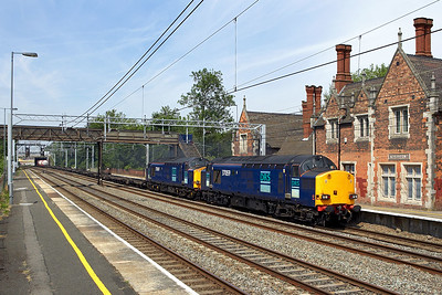 37059+37069 thunder through Atherstone on 16/06/2006 with apparently the final 4L46 1118 Ditton-Purfleet.