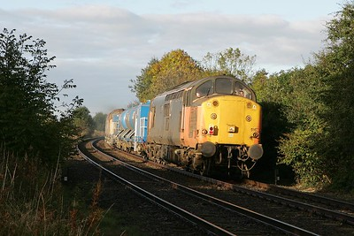 37516 leads 37503 at Flaxton on 09/10/2004 whilst working 6T83 1008 York-Malton-Doncaster TMD water cannon. The setting of this photograph highlights the reason for running the train, the line is flanked by trees just waiting to shed their leaves and cause problems.