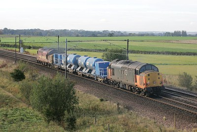 37516 trails 37503 whilst working 6T83 1008 York-Doncaster TMD via Malton past Colton Jnct on 09/10/2004.