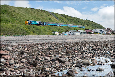 37423 'Spirit of the Lakes' passes the beach houses at Coulderton whilst in charge of 2C49 1140 Barrow in Furness-Carlisle on 24/06/2016.