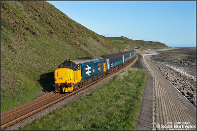 37402 propels 2C42 1737 Carlisle-Barrow in Furness along the Cumbrian coastline at St Bees on 23/05/2016.