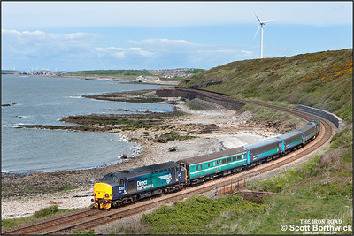 37423 'Spirit of the Lakes' brings up the rear of 2C45 1138 SO Barrow in Furness-Carlisle headed by 37606 passing Cunning Point, Lowca on 30/05/2015.