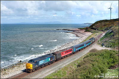 With the Scottish coastline of Dumfries & Galloway clearly visible across the Solway Firth, 37419 'Carl Haviland 1954-2012' brings up the rear of 2C41 0845 SO Barrow in Furness-Carlisle heade by 37611 at Lowca on 30/05/2015.