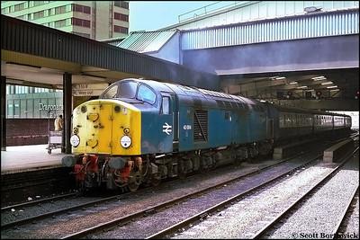 40004 restarts 1E08 0915 Bangor-Scarborough away from Leeds on 26/08/1983.
