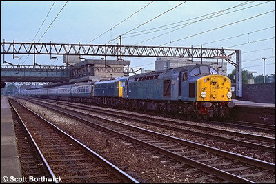 40093 stands at Stafford shortly after dragging 85017 on a Stranraer Harbour-London Euston relief on 31/07/1983.
