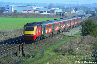43097/43086 are pictured at Catholme, to the south of Burton upon Trent, whilst working 1V41 0645 Newcastle-Plymouth on 06/04/2002. In the background the newly constructed Virgin Voyager depot 'Central Rivers' can be seen. The voyagers visible were all awaiting commissioning and entry to traffic. This view is no longer possible due to the construction of a huge warehouse building for Argos.