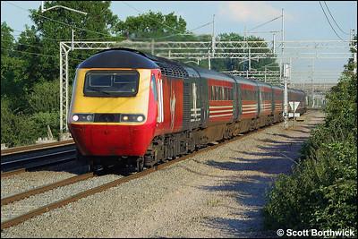 An unidentified Virgin HST speeds northwards at Cathiron on 13/07/2002.