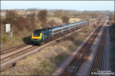 43074/43166 speed past Radwell in weak winter sunshine with 1C17 0719 Leeds-London St Pancras on 03/01/2005.