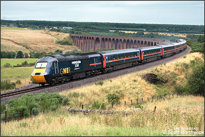 43120 complete with its 'London 2012 candidate city' logo leads 1E16 0940 Inverness-Stevenage off Culloden Viaduct on 28/08/2005. 43112 was the rear power car. This service would have normally run through to London Kings Cross, but on this occasion engineering work had closed the London end of the ECML.