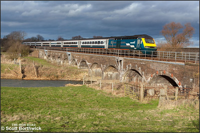 Pictured in dramatic lighting under a threatening sky, 43082/43083 cross the River Great Ouse at Radwell on 03/01/2005 whilst working 1C33 1227 Sheffield-London St Pancras.