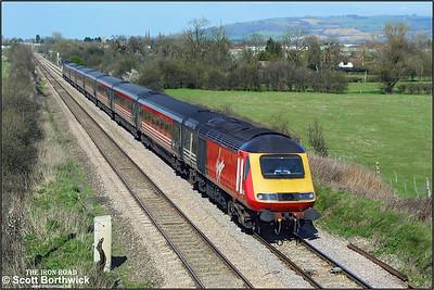 43123/43071 pass Claydon (Gloucestershire) whilst working 1V47 0710 Edinburgh Waverley-Plymouth on 26/03/2002.