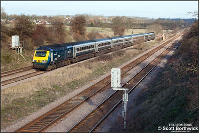 Weak winter sunshine illuminates 43089/43104 as they speed south past Radwell on 03/01/2005 with 1B17 0930 Nottingham-London St Pancras.