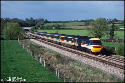 An unidentified HST forms 1V55 1311 Newcastle-Cardiff Central passing Wickwar on 18/04/1991.