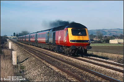 43067 leads an unidentified Virgin Cross Country service south at Homedown LC, Ashchurch during February 2001.