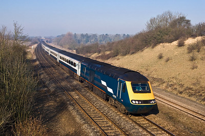 43076/43049 race down Sharnbrook bank at Souldrop on 18/02/2008 whilst forming 1C21 0828 Leeds-London St Pancras International.
