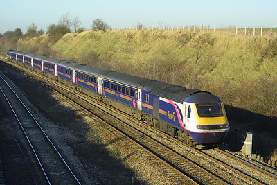 Due to signalling problems, all traffic was using the relief lines between Didcot & Reading on 18/12/2002. Here 43003/43168 catch the rays of a low winter sun in South Moreton Cutting with a London Paddington bound service.