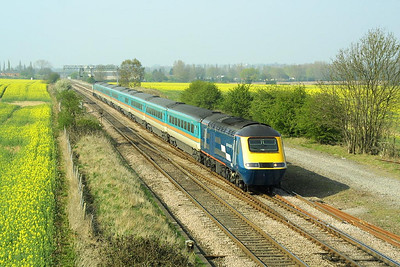With rape seed oil flowering in the adjacent fields, 43166/43048 rattle through Harrowden Jnct, Wellingborough with 1C41 1427 Sheffield-London St Pancras on 18/04/2003.