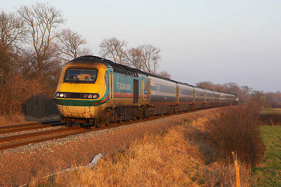 43077 with 43066 on the rear head west into the setting sun at Washstones LC, Frisby on the Wreake whilst forming 1D30 1355 London St Pancras-Nottingham on 28/01/2006.
