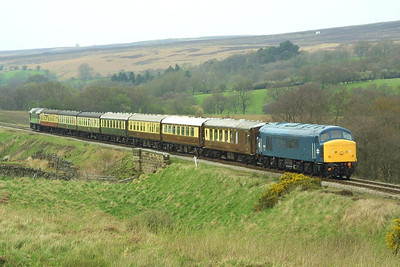 45133 brings up the rear of the 1420 Pickering-Grosmont 'Moorlander' service at Moorgates on 24/04/2004. D7628 heads the train.