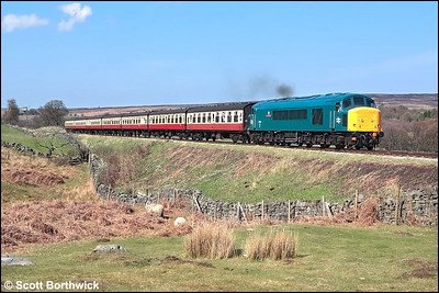 45135 '3rd Carabiner' opens up as it passes Moorgates with the 1400 Grosmont-Pickering service on 05/05/2006.