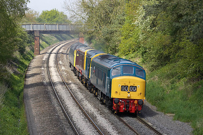 45112 leads fellow exhibits to the Mid Hants Railway for their Spring Diesel Gala passing Kings Sutton on 12/05/2005. The convey comprised 45112+20001+20227+D1013 running as 0Z52 0935 Kidderminster-Alton.