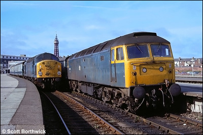 47452 awaits time at Blackpool North on 06/08/1983 with 1A35 0934 Blackpool North-London Euston with 40024 alongside on 1S91 0945 Blackpool North-Stranraer Harbour.