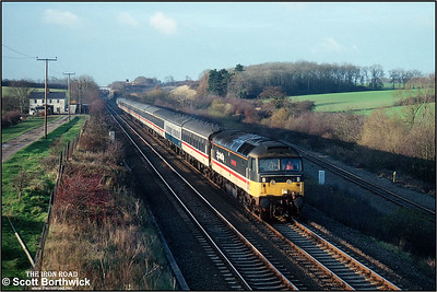 47471 heads an unidentified empty coaching stock working down Sharnbrook bank at Souldrop on 27/11/1990.
