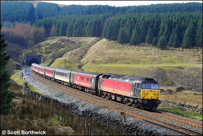 47741 'Resilient' powers away from the northern portal of Blea Moor tunnel whilst working 1S46 0655 Birmingham New Street-Edinburgh Waverley on 23/03/2002.
