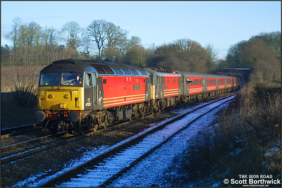 47828 'Severn Valley Railway, Kidderminster-Bewdley-Bridgnorth' catches the weak winter sun approaching Whitacre Junction dragging 87024 'Lord of the Isles' forming 1G23 1050 London Euston-Wolverhampton on 05/01/2003.