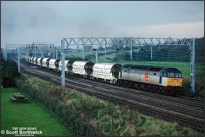47359 powesr 6M72 2215 FSX St Blazey SS-Cliffe Vale approaching Norton Bridge on 28/11/1990.