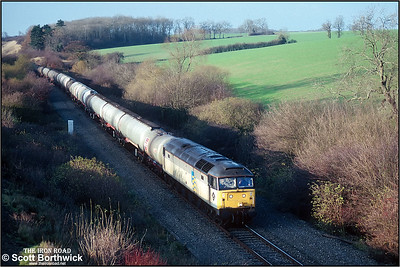 47212 working 6V52 0848 MWFO Lindsey Oil Refinery-Longley Oil Terminal on the slow at Souldrop on 27/11/1990.