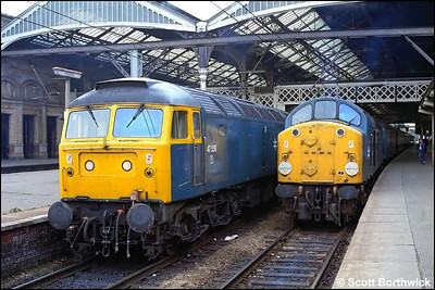 47536 awaits time at Preston with 2P29 0715 Preston-Barrow in Furness as 40024 prepares to depart with 1M17 0135 Stranraer Harbour-Blackpool North on 06/08/1983.