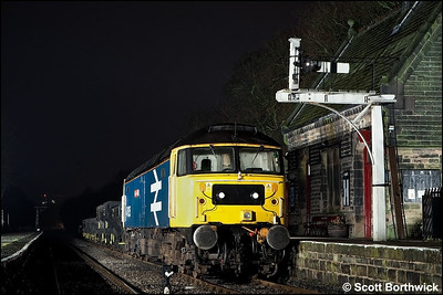 47635 'Jimmy Milne' stands at Darley Dale with a short ballast train on 27/02/2010.