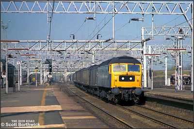 47284 speeds through Nuneaton Trent Valley whilst in charge of 3B05 0825 Bangor-Aylesbury parcels on 03/04/1984.